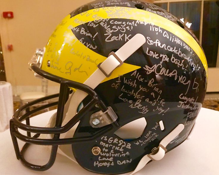 Brian and Alex both went to University of Michigan along with many other family and friends at the wedding. For their special gift, we bought them an official UM football helmet and even play the University of Michigan Fight Song. Go Wolverines!