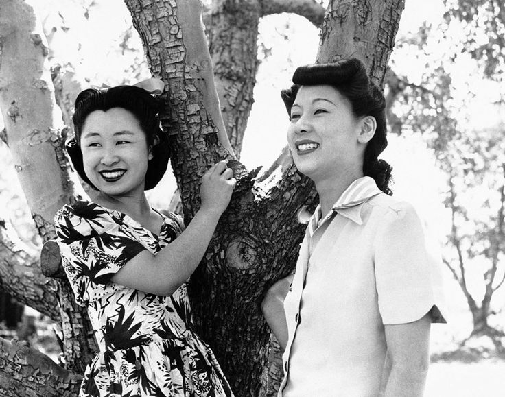 22 Chilling Pictures Of Life At Japanese Internment Camps - Florence Yamaguchi, left, and Kinu Hirashima, both from Los Angeles, relax under an apple tree at the war relocation authority center in Manzanar, California in June, 1942.