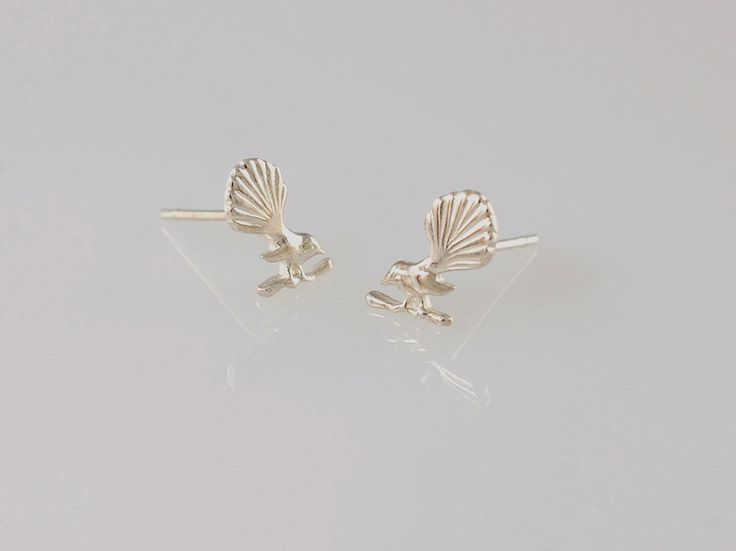 Fantail Stud Earrings. NZ$69 silver and NZ$199 in 9ct yellow gold. The fantail bird or Piwakawaka is known for its friendly 'cheet cheet' call and energetic flying antics, the aptly named fantail is one of the most common and widely distributed native birds on the New Zealand mainland. These sweet little studs are a great size for everyday wear. Jewellery made @jewelbeetle in Nelson, New Zealand.