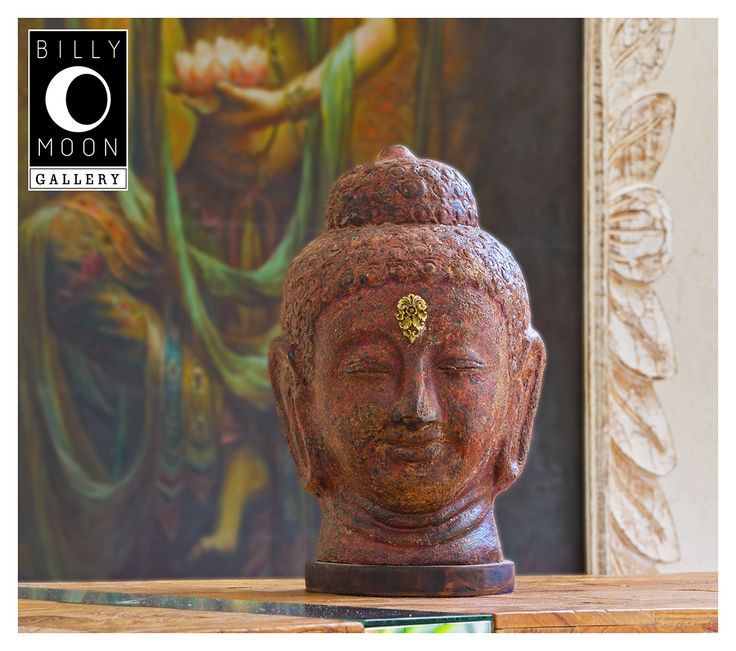 Buddha Head   Terracotta from Bali. Multi-layered paint finish.Wood base. Cast solid brass decorative detailing.  A1096