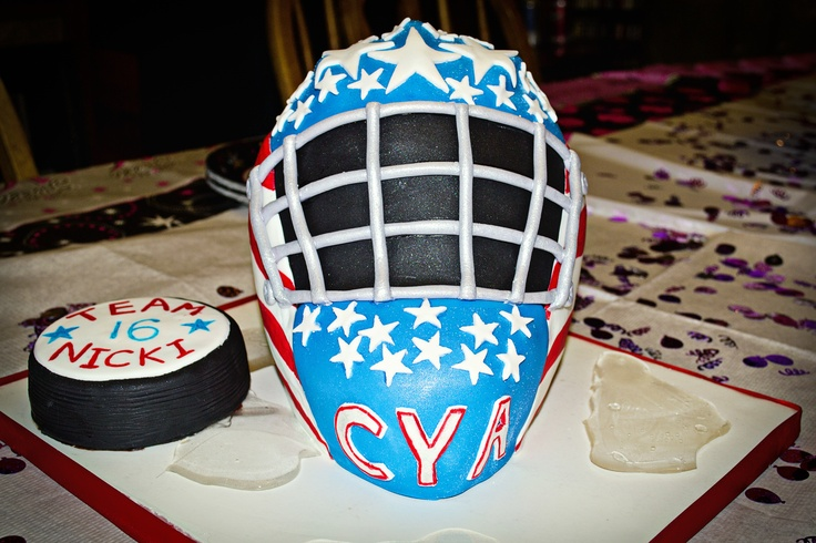 "3D Hockey Goalie Mask - 3D hockey goalie mask carved out of a wondermold pan and 9x13 cake cut in half and stacked. Thanks to puppylove for the help with the mask.  Puck is cake. ""ice"" is made from isomalt."