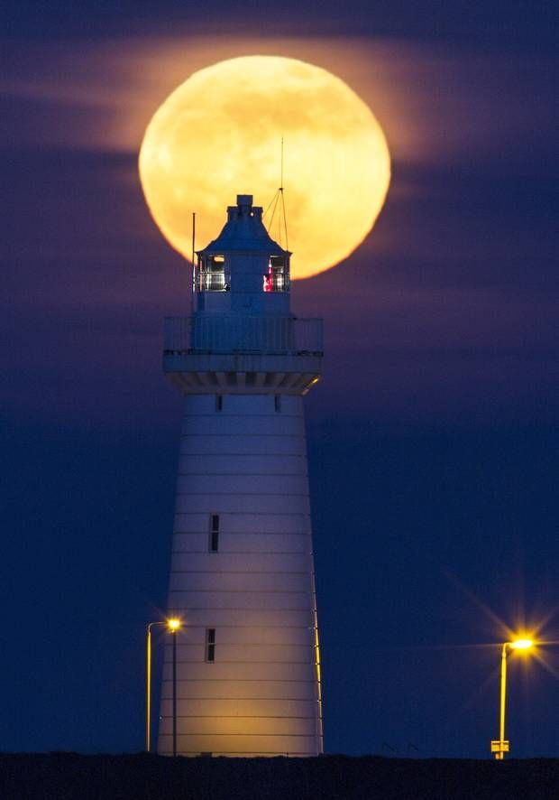 Full #moon above Donaghadee #lighthouse. Picture by Bernie Brown.Stunning images captured by a number of astrophotographers from Northern Ireland are set to go on display in Belfast.Photographs showing the city's lough at night, a full moon rising above Donaghadee lighthouse and a wolf moon - January's full moon - making its way past Harland and Wolff's Samson crane will form part of an exhibition at the Linen Hall Library next month. - http://dennisharper.lnf.com/