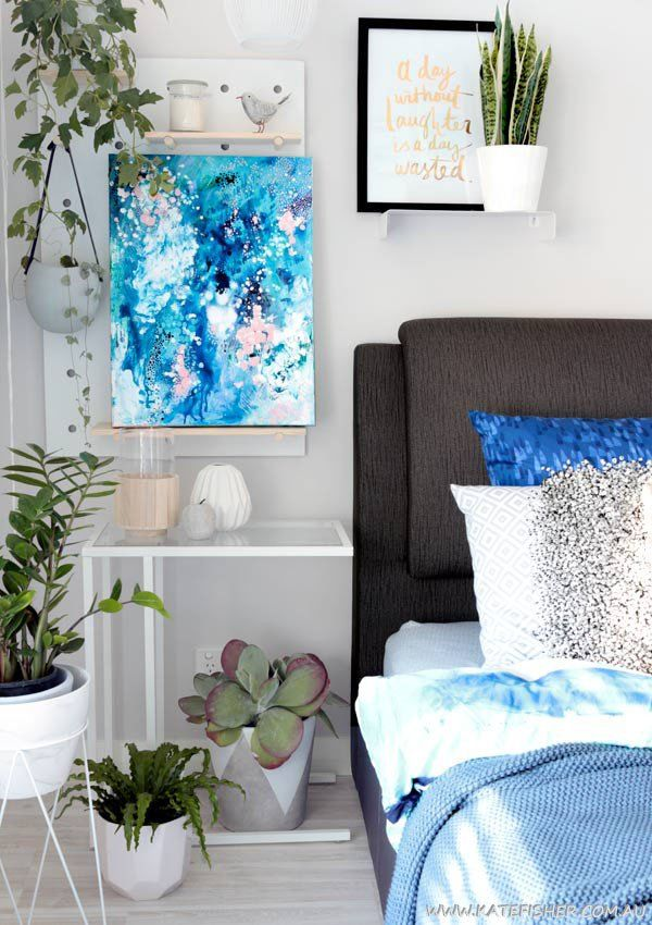 """""""When Snow Falls"""" original abstract artwork in blues by Australian artist Kate Fisher. Styled in master bedroom with adairs bedding, kmart pegboard and indoor plants."""