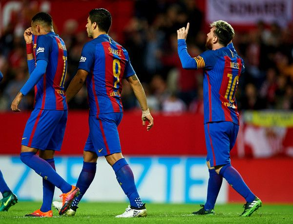 Lionel Messi of FC Barcelona  celebrates after scoring their first goal during the match between Sevilla FC vs FC Barcelona as part of La Liga at Ramon Sanchez Pizjuan Stadium on November 6, 2016 in Seville, Spain.