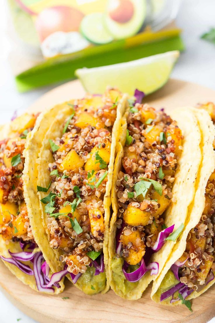 10-MINUTE QUINOA TACOS with a spicy mango-lime filling, red cabbage and creamy guacamole dip on the bottom! [vegan gluten-free]