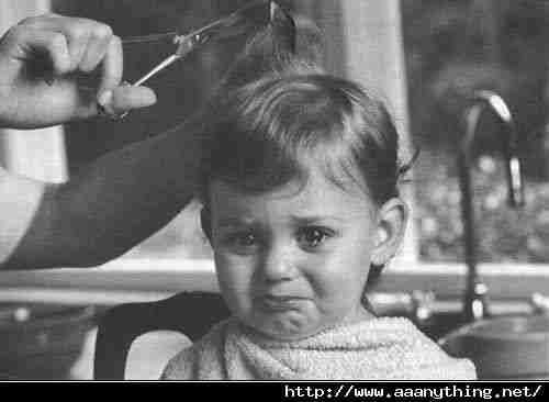 Cute kid crying while having haircut done