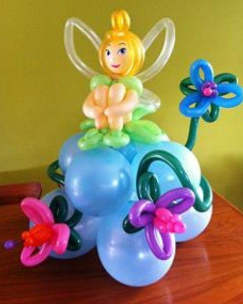 Balloon art fairy on a flower.  #balloon #art #fairy #balloon #sculpture #fairy #balloon #centerpiece #fairy #balloon #column #fairy #balloon #arch #fairy #balloon #twist #fairy