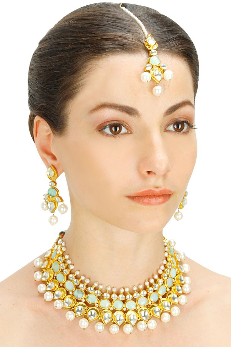 Gold finish semi precious stones and pearl three piece necklace set available only at Pernia's Pop-Up Shop.