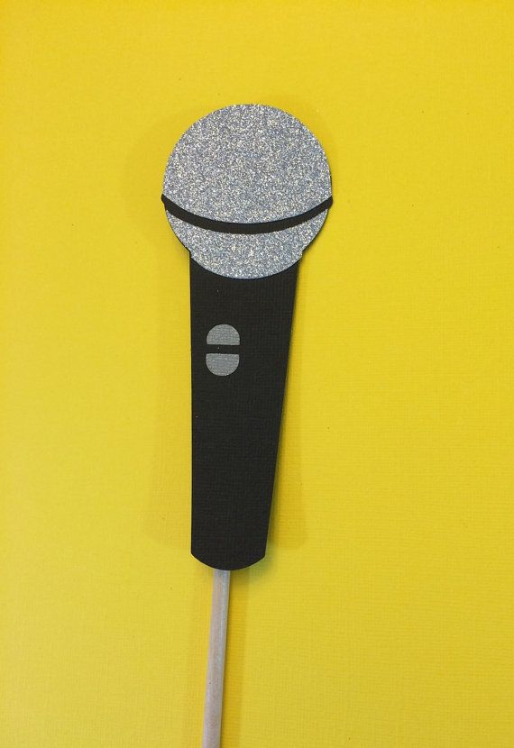 Fun microphone photo booth prop with glitter!   Please leave date of event at checkout. All props made with quality cardstock and  attached to wood dowels. US bound orders will ship USPS Priority ( 2-3 days) with tracking number.  Please read shipping policy before making purchase.  Measurements  1- Microphone approx 6  © All Designs featured in this listing are property of Crafting by Denise and should not be copied or duplicated in any way.