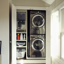 small laundry - stacked washer/ dryer and storage in closet