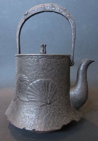 """Japanese Antique Iron Tetsubin with Shells      Antique Japanese cast iron tetsubin (tea kettle), cast with wonderful design of shells on each side, beautiful shape with tall handle and iron lid, Meiji Period. Size: 11"""" high"""