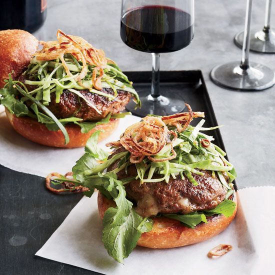 Cheddar-Stuffed Burgers with Pickled Slaw and Fried Shallots   These fantastic cheese-stuffed burgers call for ground beef chuck and store-bought brioche buns.