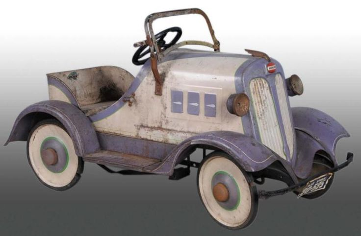Pressed Steel Blue Streak Pedal Car. All original paint and body trim with some surface rust.