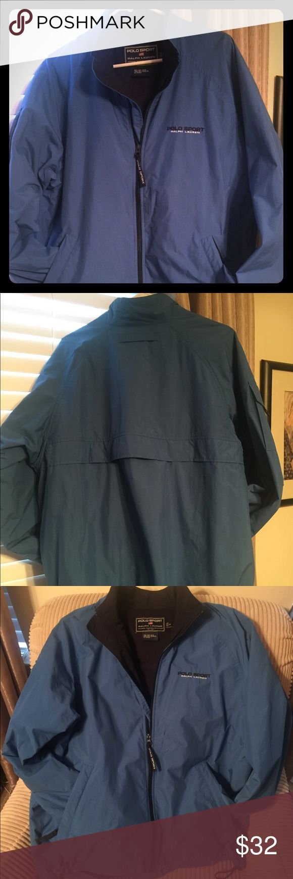 Ralph Lauren Polo Sport Jacket. Men's Polo Sport Windbreaker. Primary color blue with black trim.  Full zipper front closure. Pocket on right sleeve. Two front waist welt zip pockets. Inside pocket. Drawstring at right and left side of hem.    Excellent condition!     Outside -100% nylon/ Inside-100% polyester. Polo by Ralph Lauren Jackets & Coats Windbreakers