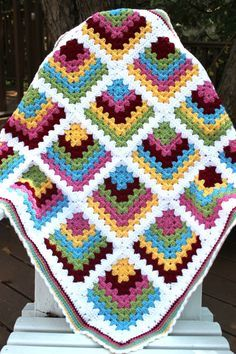 I saw this blanket at the Crochet Again blog, and there was never any doubt that I would make one. I just loved her take on the traditional granny square and, as luck would have it, the yarn color...