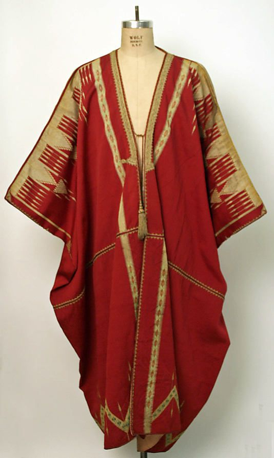 The Piano Bar on the Street Called Straight (Bab Sharki eastern gate of Damascus) had panels woven like this coat hanging form mosaic cornices over the windows. The new weaving although nice is not in the league of the coat shown here. Aida Dalati Syrian hand woven coat c. 1900