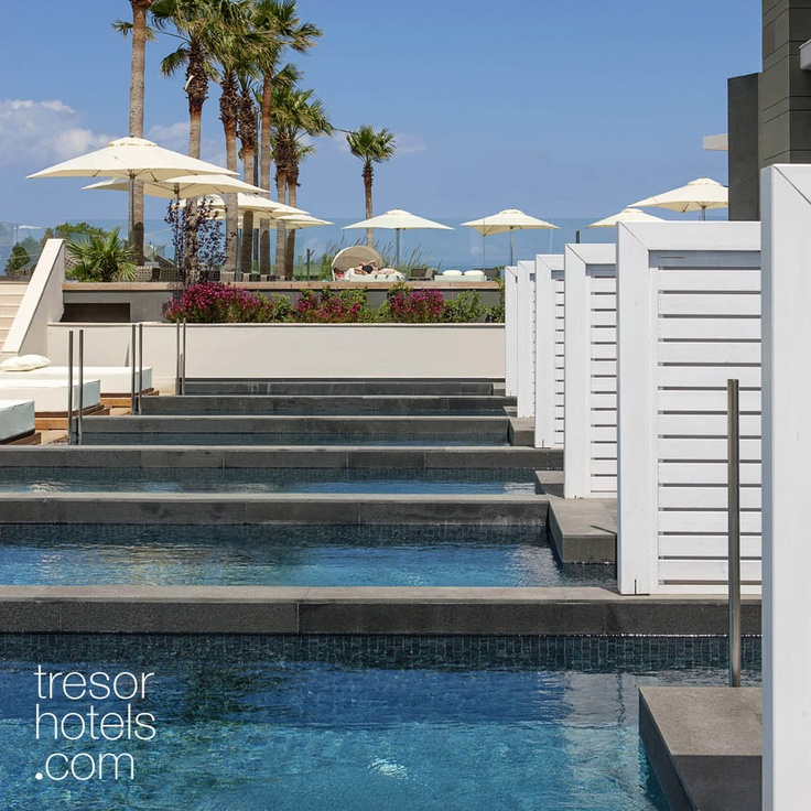 Trésor Hotels and Resorts_Luxury Boutique Hotels_#Greece_ Great Alternative, the sun-beds within the large communal swimming pool will entice you to indeterminate and invigorating tanning sessions, while you slowly sip on your colorful cocktail...courtesy of the pool bar.