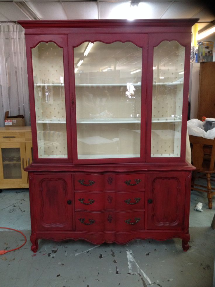 Cabinet is done in Shabby Paints. Outside colors are Betsy Ross Red with Black Vax. Inside colors: Worn White and Clear Vax then the back is lined with light Gold Fabric.
