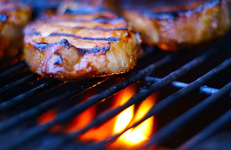 Grilled pork chops with garlic and ginger. Go to GrillGrrrl.com for ...