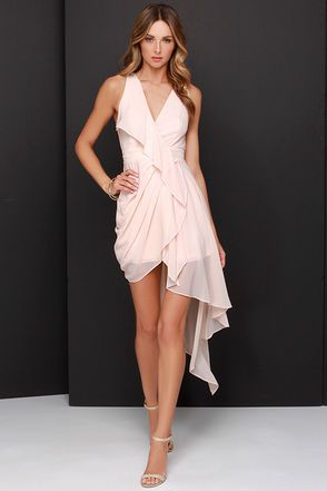 "You're invited to the party of the season, and with the Elegant Gathering Blush Pink High-Low Dress, you're sure to make a grand entrance! Lovey blush pink chiffon flutters across a sleeveless, surplice bodice (and banded waist), while a loose panel cascades over the pleated, tulip skirt. An asymmetrical high-low hem adds the perfect ethereal touch to this ensemble. Hidden side zipper with clasp. Lined to mid-thigh. Dress measures 19"" longer at back. 100% Polyester. Hand Wash Cold. Imported."