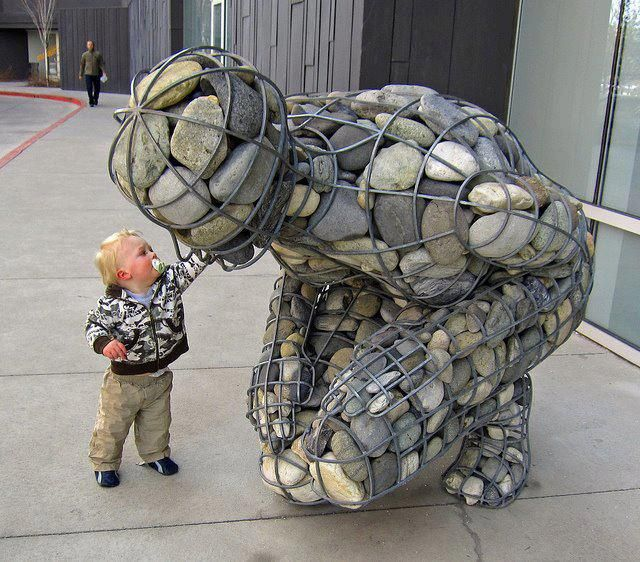 Gabion river stone sculpture at the Nevada Museum of Art in Reno, Nevada. photo by Benjamin Fish on Flickr.