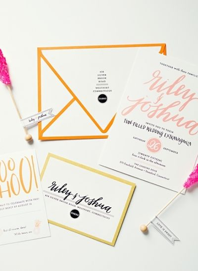 Bright colors accented with calligraphy make this wedding stationery modern