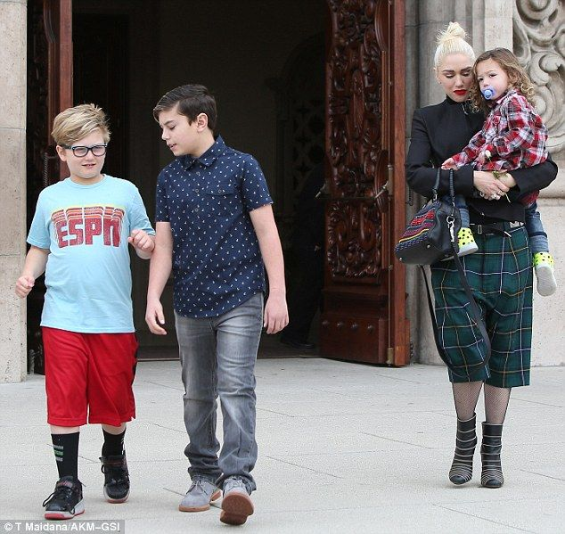 A family affair: The girlfriend of Blake Shelton also brought along her two eldest sons, K...
