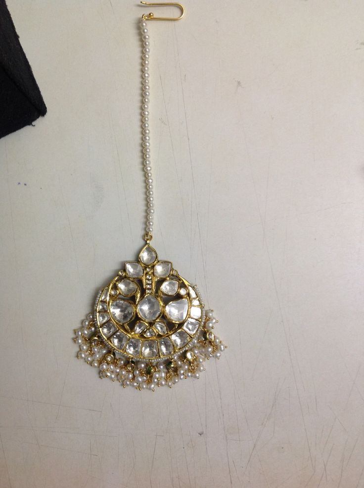 Big bold all diamond Polki gold mang teeka. @Umrao Jewels.