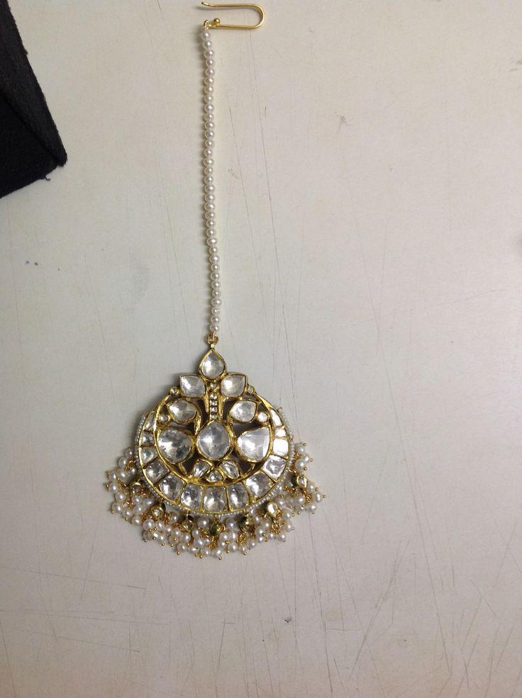 Big bold all diamond Polki gold mang teeka. @Umrao Jewels.