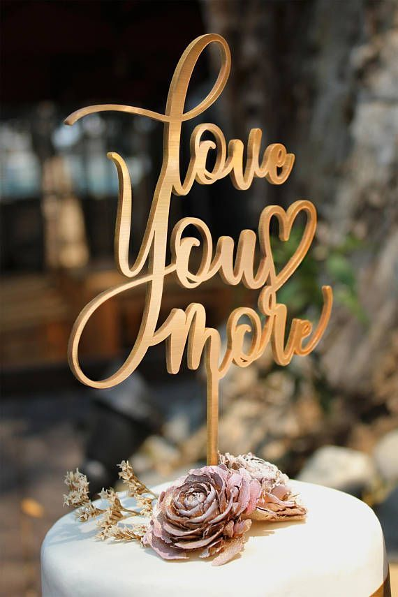 love you more wedding cake topper - plus a curated collection of fun and festive cake toppers for weddings and every celebration in between! #gartergirlloves