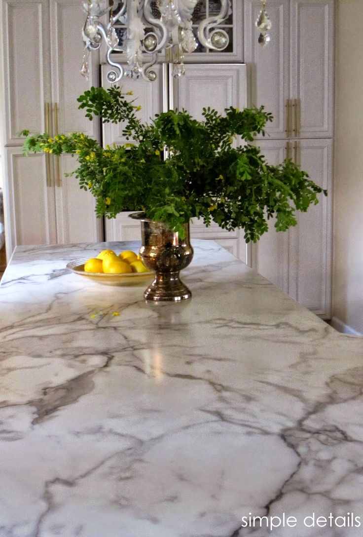 Formica has come a long way!  I revealed our Formica 180fx Calacatta Marble counter top back in May, along with  my One Room Challenge Ki...