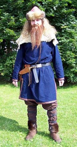 Viking     North warrior's clothing consists of blue duvetyn tunic (kjortel) and loose brown duvetyn trousers (byxor). Accessories were made by owner.