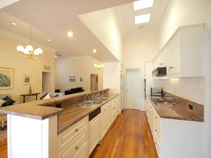 Warm Nuance Ideas for Galley Style Kitchen Design