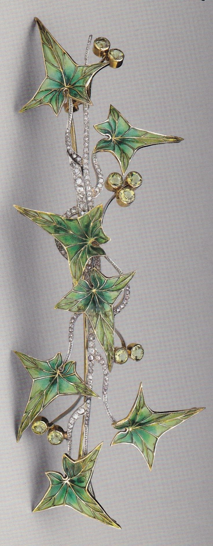 Platinum, gold, enamel, diamond and peridot 'Ivy' brooch, by an unknown maker, possibly Austrian, circa 1900. #ArtNouveau