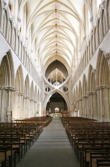 Looking east in the Gothic nave (early 13th century), with the famous scissor arches added in 1338. Wells Cathedral, Wells, Somerset, England. Photo © Holly Hayes.