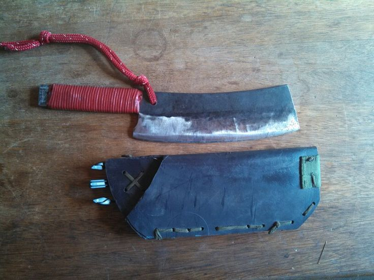 """""""Big Bertha"""" Bush Cleaver.. made this from a leaf spring. For when you don't want to carry a hatchet, Machete, and big blade. Bit weighty but cuts through brush, chops and splits, slices and dices, and holds a razor edge. Hones well too. Sheath made from Olive Barrel lid. Heated in oven then folded to shape. Red handle is """"Plasti Dip"""" for tool handles, and paracord. Red so I can see it in the brush."""