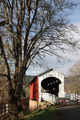 Currin Covered Bridge spans the Row River at Cottage Grove, Oregon. Oregon's only covered bridge with white portals and red sides.