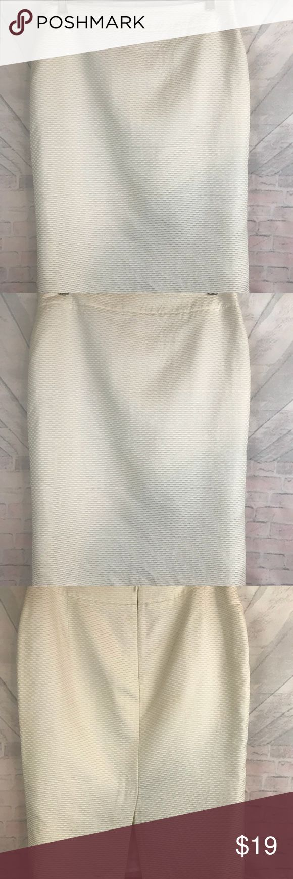 "Armani Collezioni Womens Size Medium Skirt. Barely Worn. Armani Collezioni Womens Size Medium Skirt. Lined.  Cream pattern.  Zipper in back with inside button. Made of 77% Cotton and 23% Silk.  Lining made 100% Acetate.   Waist approximately 30 1/2 inches without stretching and length approximately 24 1/4 inches. 8"" slit along the back. Armani Collezioni Skirts"
