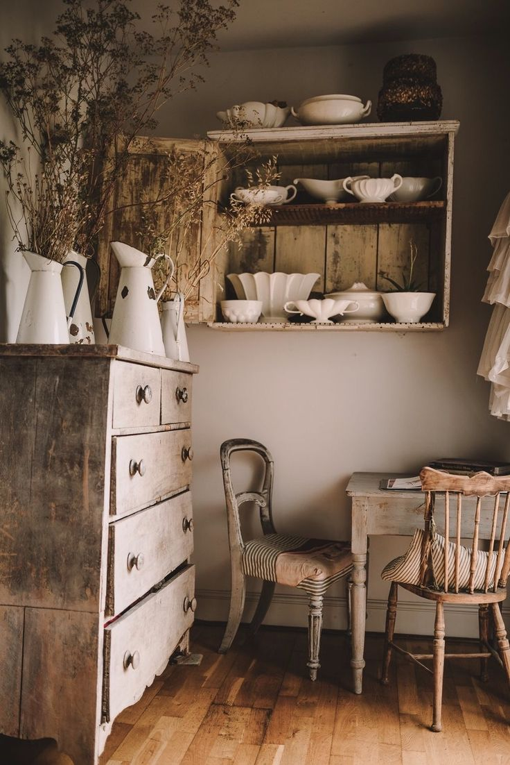 Enamelware pitchers in white with with brown furniture. I love the simplicity of it~~~
