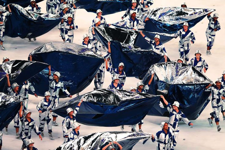 Covered in silver:     Artists preform during The 2016 Summer Olympics Opening Ceremony at Maracana Stadium on Aug. 5, in Rio de Janeiro, Brazil.