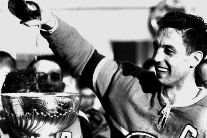 Jean Béliveau, #4 of the Montreal Canadiens, pours champagne into the Stanley Cup Trophy after the Canadiens defeated the Chicago Blackhawks by a score of 4-0 in Game 7 of the 1965 Stanley Cup Finals on May 1, 1965 at the Montreal Forum in Montreal, Quebec, Canada.