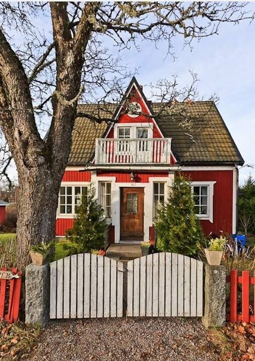 adorable red cottage and pocket fence.