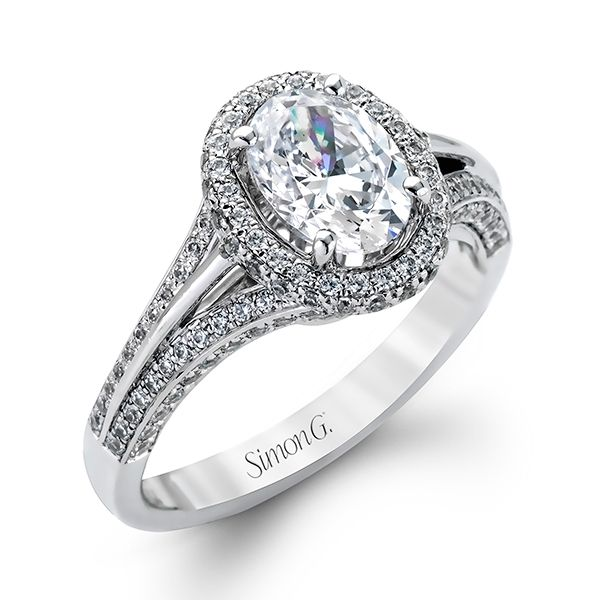Designed by Simon G. Jewelry, this 18k white gold engagement ring contains .77 CTW diamonds.