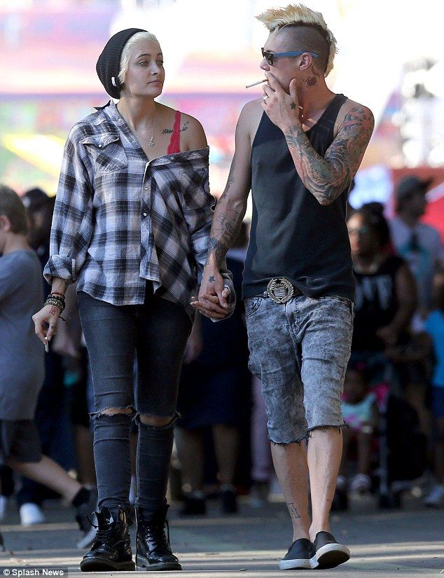 Still struggling to give up smoking: Paris Jackson and her rocker beau Michael Snoddy both lit up as they strolled around the LA County Fair, hand-in-hand, on Saturday
