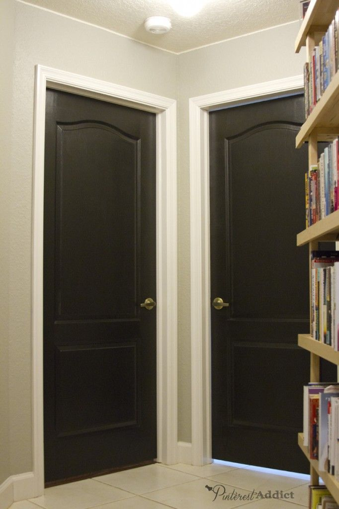 black doors: hallway looking at the laundry room and bedroom