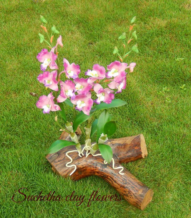 Dendrobium flowers.. Handmade clay floweres.. https://www.facebook.com/suchethaclay?ref=hl
