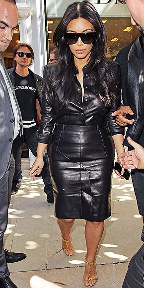 Obsessed or Hot Mess? Vote on These Daring Looks | LEATHER ON LEATHER | Kim Kardashian's Balmain top and Calvin Klein Collection pencil skirt would definitely feel like a hot mess (in that we'd be sweating bullets in it). But it's up to you to weigh in on if it looks like one, too.