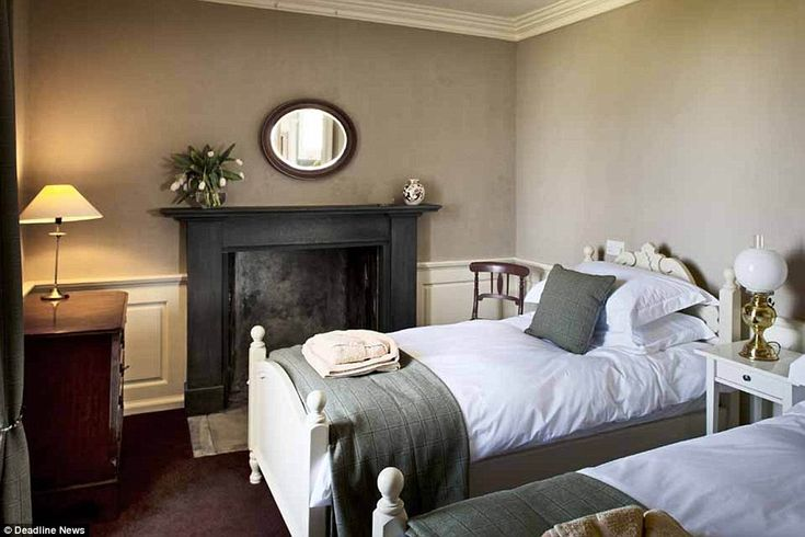 Peaceful: The house's twin bedroom, pictured, is on the first floor of the property and has been painted in tasteful neutral colours
