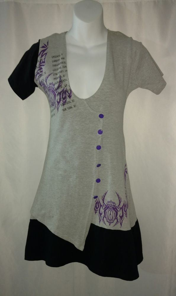 This dress features a stretchy form flattering fit, a sexy low cut, a Journey logo on the front side, tour dates in the shoulder area, a vibrant purple accent color, chic buttons down the front, a color block design, and an assymetrical bottom hem. This item is rare.  eBay!