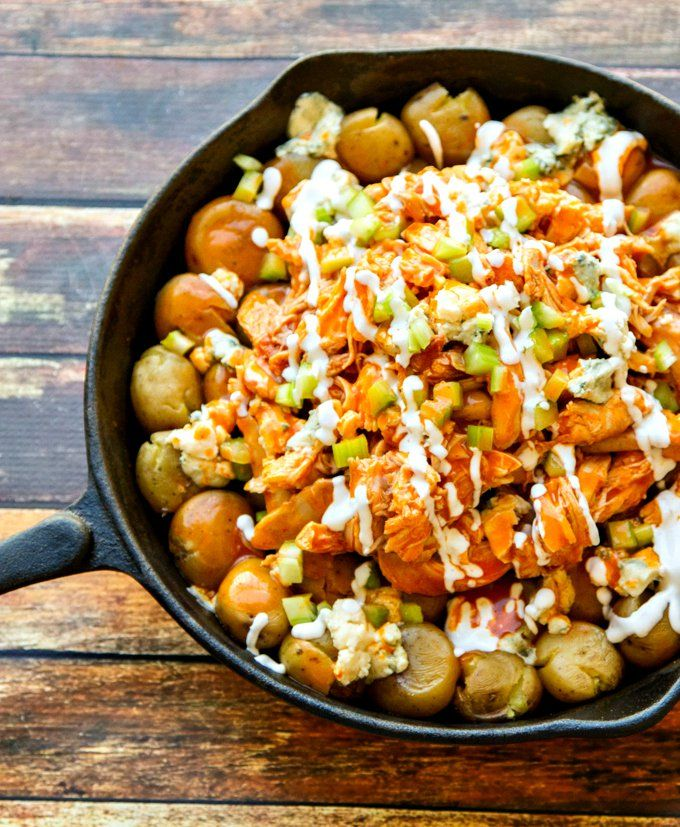 a one-pan dish!  This Buffalo Chicken & Potato Skillet is a fun variation to buffalo wings or even a buffalo wing dip. Crispy potatoes topped with shredded chicken, wing sauce, blue cheese, celery & a drizzle of dressing – perfect for an easy dinner or a Super Bowl appetizer!